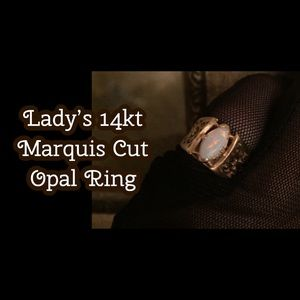 Lady's 14kt Marquise Cut Opal Ring